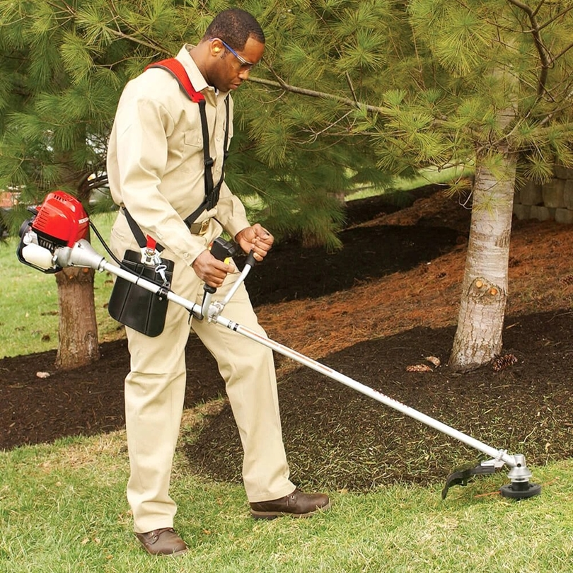 What is the difference between brush cutter and lawn mower?